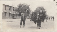 Two Soldiers Carrying Branches