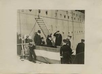 Woodrow Wilson, Edith Bolling Wilson, and an Unidentified Man Disembarking from a Ship