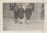 Three Soldiers Standing in front of a Building