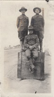 Three Soldiers Posing on a Box