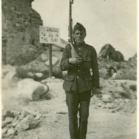 Soldier and Danger Sign [Ypres, Belgium?]