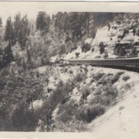 View of Train Moving around a Mountain