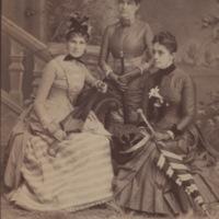 Portrait of three women with umbrellas