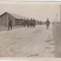 Soldiers Walking Down a Road