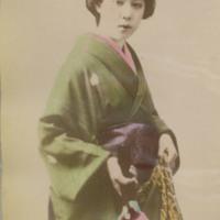 Woman in Kimono Holding Fabric