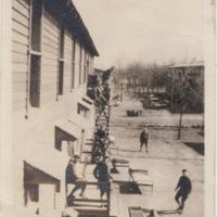 Men outside Training Camp Barracks