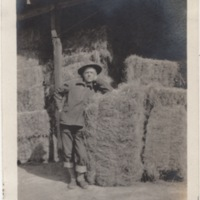 Soldier Leaning against Hay Bale