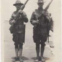 Two Soldiers Standing with Rifles