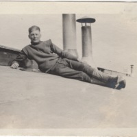 Soldier Posing on Roof