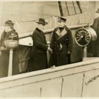 Woodrow Wilson and Edward McCauley Jr. on the Bridge of the USS George Washington