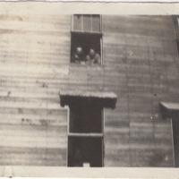 Two Soldiers Leaning out a Window