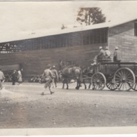 View of Camp with Wagon and Building