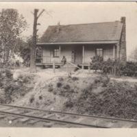 Cabin opposite Train Tracks