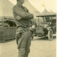 Soldier with Automobile and Tents